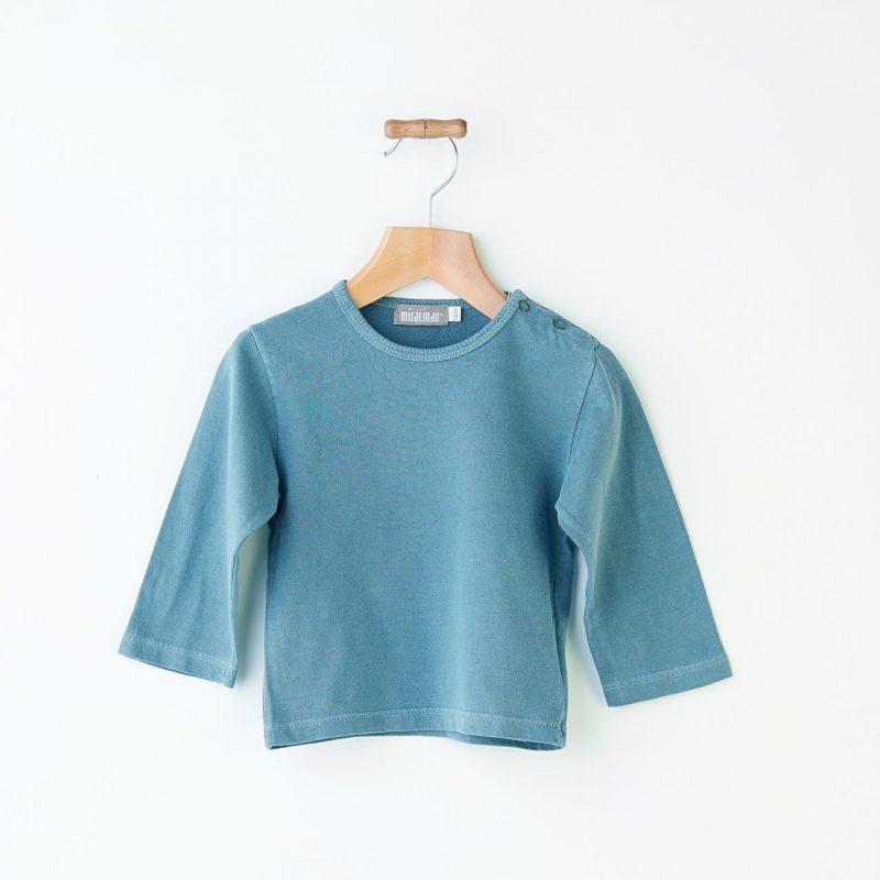 Camiseta básica de bebé de color azul verdoso diferente y de algodón.